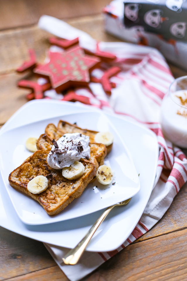 gluten-free french toast without syrup and topped with banana slices whipped cream and chocolate