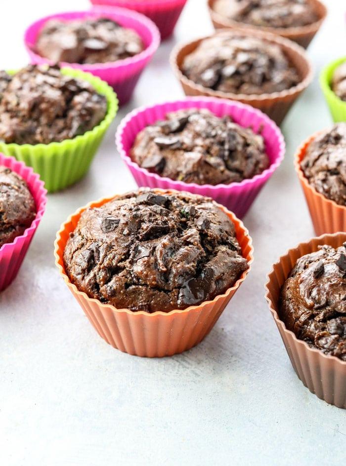 paleo chocolate zucchini muffins in colorful baking cups