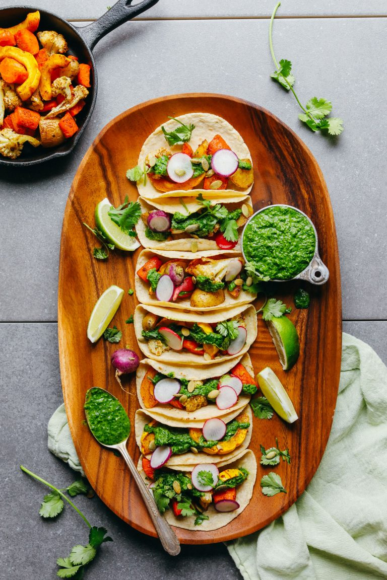roasted vegetable tacos with chimichurri sauce on tray
