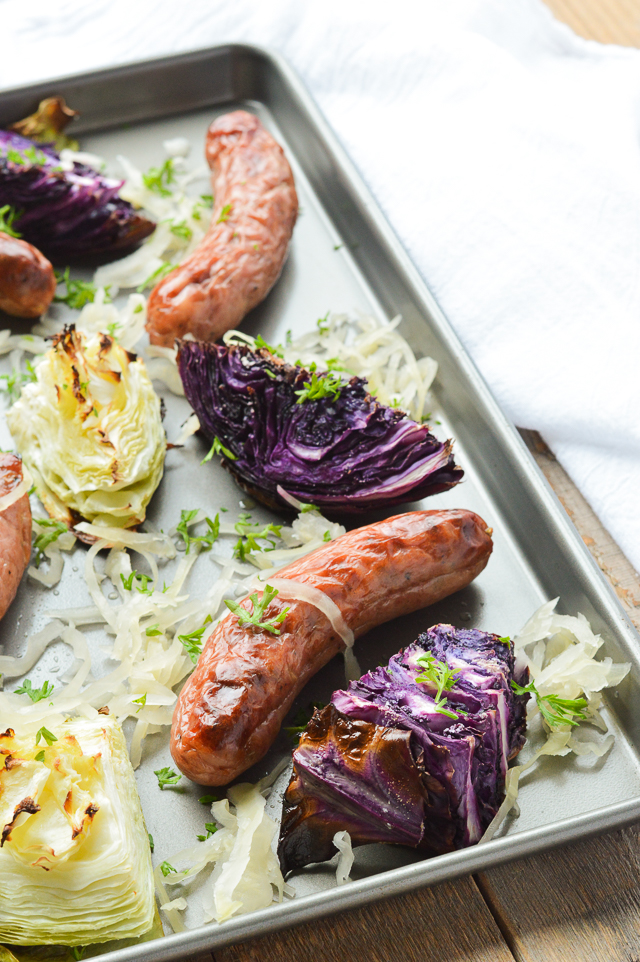 sausage cabbage and sauerkraut on sheet pan
