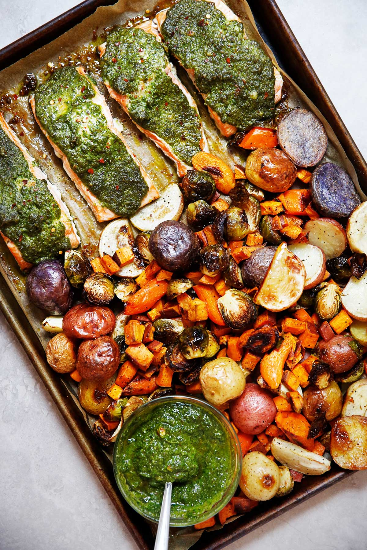 sheet pan root vegetable salmon with pesto